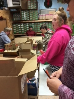 Sorting school supplies for Project Christmas Child boxes