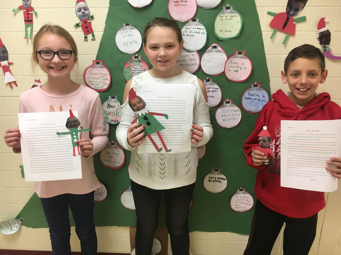 5th grade students with their elf stories and their elves!