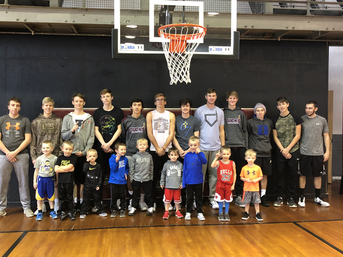 HS team with the Lil' Hoopsters
