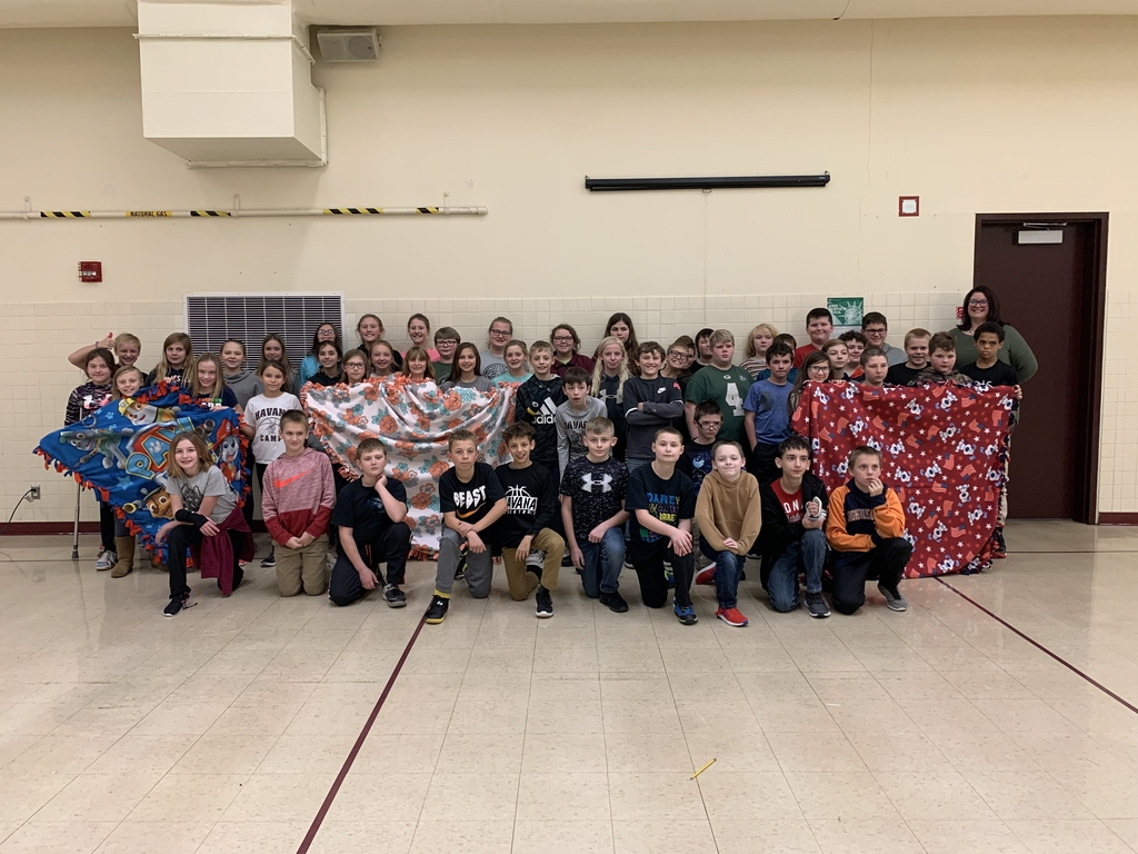 6th grade students donating blankets.
